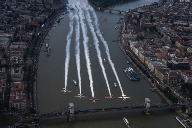 Peter Besenyei of Hungary leads Petr Kopfstein of the Czech Republic, Michael Goulian of the United States, Matt Hall of Australia and Ben Murphy of Great Britain over the city prior to the fourth stage of the Red Bull Air Race World Championship in Budapest, Hungary on June 20, 2018.