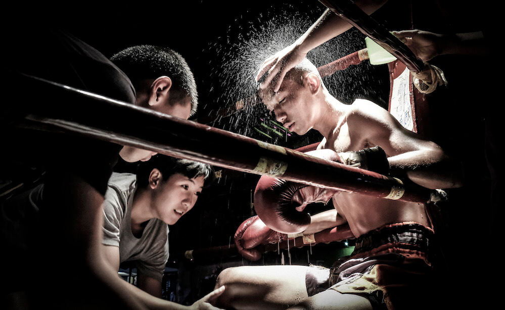 Corner team provides their duties in a thaiboxing match, Chiang Mai, Thailand