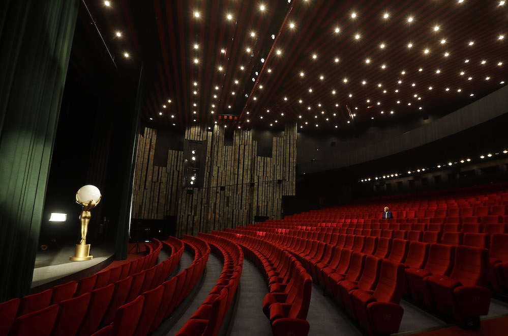 A staff member sits inside an empty cinema before a broadcast of an opening ceremony, as the Karlovy Vary International Film Festival launches a nationwide programme to bring its films to cinemas around the country after cancelling its main events following the coronavirus disease (COVID-19) outbreak in Karlovy Vary, Czech Republic, July 3, 2020.  REUTERS/David W Cerny