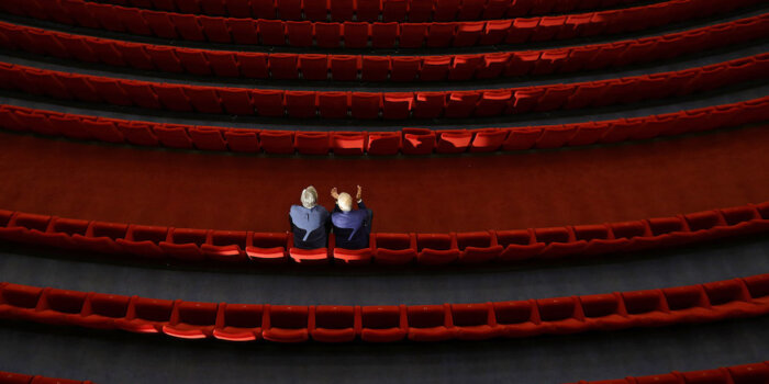 Festival President Jiri Bartoska And A Staff Member Sit Inside An Empty Cinema Before A Broadcast Of An Opening Ceremony, As The Karlovy Vary International Film Festival Launches A Nationwide Programme To Bring Its Films To Cinemas Around The Country After Cancelling Its Main Events Following The Coronavirus Disease (COVID-19) Outbreak In Karlovy Vary, Czech Republic, July 3, 2020.  REUTERS/David W Cerny